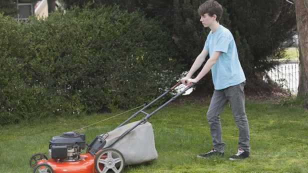 Teen mowing the lawn.jpg